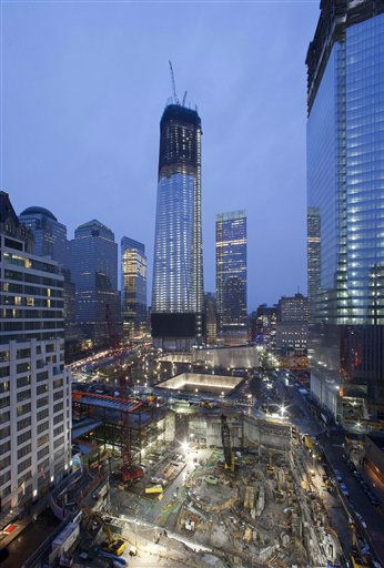 "<div class=""meta image-caption""><div class=""origin-logo origin-image ""><span></span></div><span class=""caption-text"">One World Trade Center, center, now up to the 100th floor, and Four World Trade Center, right, overlook the ongoing construction of the site, Sunday, April 1, 2012 in New York. The unfinished One World Trade Center is one of the city's tallest structures. If construction continues at its current pace, it will pass the Empire State Building this spring. Four WTC will top out at 72 floors. (AP Photo/Mark Lennihan) (AP Photo/ Mark Lennihan)</span></div>"
