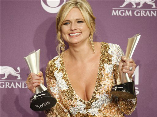 Miranda Lambert poses backstage with the awards for album of the year for &#34;Four the Record&#34; and female vocalist of the year at the 47th Annual Academy of Country Music Awards on Sunday, April 1, 2012 in Las Vegas. &#40;AP Photo&#47;Isaac Brekken&#41; <span class=meta>(AP Photo&#47; Isaac Brekken)</span>