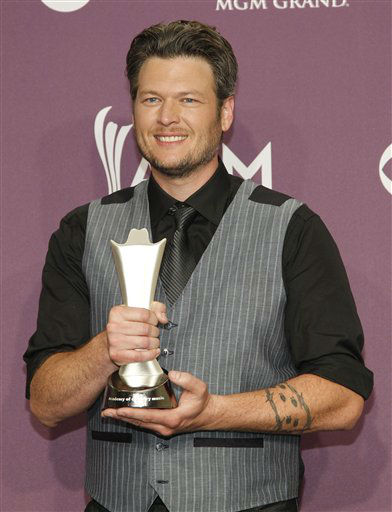 Blake Shelton poses backstage with the award for male vocalist of the year at the 47th Annual Academy of Country Music Awards on Sunday, April 1, 2012 in Las Vegas. &#40;AP Photo&#47;Isaac Brekken&#41; <span class=meta>(AP Photo&#47; Isaac Brekken)</span>