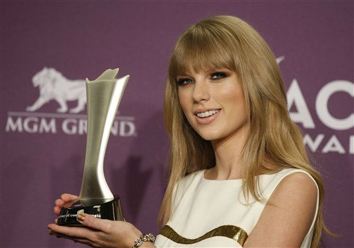 Taylor Swift poses backstage with the award for entertainer of the year at the 47th Annual Academy of Country Music Awards on Sunday, April 1, 2012 in Las Vegas. &#40;AP Photo&#47;Isaac Brekken&#41; <span class=meta>(AP Photo&#47; Isaac Brekken)</span>