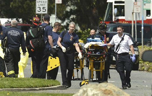 "<div class=""meta ""><span class=""caption-text "">Emergency officials walk with a gurney outside of Oikos University in Oakland, Calif., Monday, April 2, 2012. A suspect was detained Monday in a shooting attack at a California Christian university that sources said has left at least five people dead. (AP Photo/Noah Berger) (AP Photo/ Noah Berger)</span></div>"