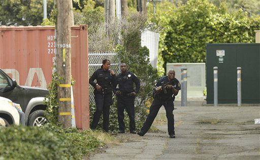 Oakland police officers patrol the area after a school shooting at Oikos University in Oakland, Calif., Monday, April 2, 2012. A suspect was detained Monday in a shooting attack at a California Christian university. &#40;AP Photo&#47;Noah Berger&#41; <span class=meta>(AP Photo&#47; Noah Berger)</span>