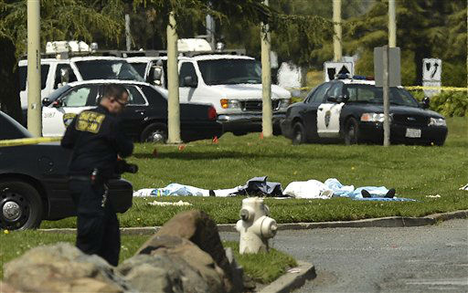 Bodies lie covered on the grass as Oakland Police work near Oikos University in Oakland, Calif., Monday, April 2, 2012. A gunman opened fire at Oikos University in California Monday, killing at least five people, law enforcement sources close to the investigation said. Police say they have a suspect in custody. &#40;AP Photo&#47;Noah Berger&#41; <span class=meta>(AP Photo&#47; Noah Berger)</span>