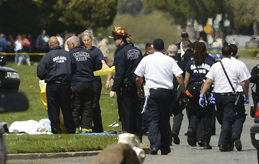 "<div class=""meta ""><span class=""caption-text "">Oakland Police cover bodies near Oikos University in Oakland, Calif., Monday, April 2, 2012. A gunman opened fire at Oikos University in California Monday, killing at least five people, law enforcement sources close to the investigation said. Police say they have a suspect in custody. (AP Photo/Noah Berger) (AP Photo/ Noah Berger)</span></div>"