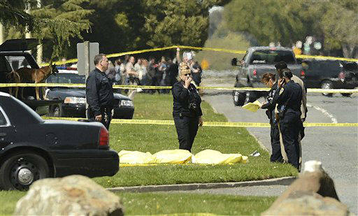 "<div class=""meta ""><span class=""caption-text "">Oakland Police work after a school shooting at Oikos University in Oakland, Calif., Monday, April 2, 2012. A gunman opened fire at the university, killing at least five people, law enforcement sources close to the investigation said. Police say they have a suspect in custody. (AP Photo/Noah Berger) (AP Photo/ Noah Berger)</span></div>"