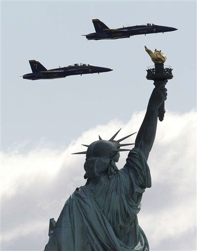 Two US Navy Flight Demonstration Squadron jets,  better known as Blue Angels, seen from Liberty State Park in Jersey City, N.J., execute a survey flight over the Statue of Liberty, Monday, April 2, 2012. The two F&#47;A-18 Hornet Fighter Jets, flew practice runs to familiarize and evaluate a potential flight course for the upcoming US Navy War of 1812 commemoration during this year?s Fleet Week celebration in May. &#40;AP Photo&#47;Julio Cortez&#41; <span class=meta>(AP Photo&#47; Julio Cortez)</span>