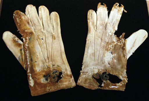 "<div class=""meta ""><span class=""caption-text "">A pair of men's cotton gloves from the RMS Titanic Inc. are on display at Guernsey's Auctioneers & Brokers,  Wednesday, April 4, 2012 in New York.   The auction of more than 5,000 Titanic artifacts a century after the luxury liner's sinking has stirred hundreds of interested calls, with some offering to add to the dazzling trove already plucked from the ocean floor.(AP Photo/Mary Altaffer) (AP Photo/ Mary Altaffer)</span></div>"