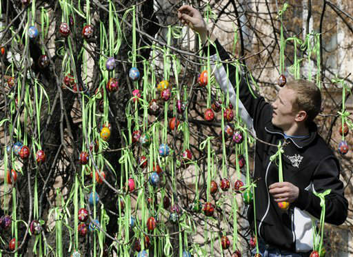 A man decorates a tree with Easter eggs in Kiev, Ukraine, Thursday, April 5, 2012. Orthodox Easter will be celebrated on Sunday, April 15. &#40;AP Photo&#47;Sergei Chuzavkov&#41; <span class=meta>(AP Photo&#47; Sergei Chuzavkov)</span>