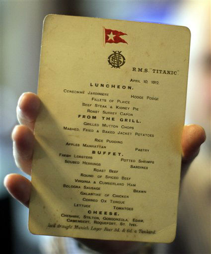 "<div class=""meta ""><span class=""caption-text "">A member of staff from the Auction house Aldridge and Son holds an original Titanic menu from April 10th 1912, that has recently been sold for 76,000 pounds (US$122,000 euro91,000)  which is part of a   unique exhibition relating to the ill-fated liner on display at Belfast City Hall, Northern Ireland, Friday, April, 6, 2012.  The Titanic exhibition is on display to the public which has many  items on show.  (AP Photo/Peter Morrison) (AP Photo/ Peter Morrison)</span></div>"