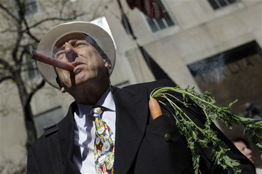 "<div class=""meta ""><span class=""caption-text "">Wayne Barr, of Merrick, N.Y., smokes an orange cigar during the Easter Parade Fifth Ave.,  Sunday, April 8, 2012 in New York.  (AP Photo/Mary Altaffer) (AP Photo/ Mary Altaffer)</span></div>"