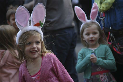 Emily Radke, 6, left, reacts as she is entertained by a puppeteer during the Easter Parade on Fifth Ave.,  Sunday, April 8, 2012 in New York.  &#40;AP Photo&#47;Mary Altaffer&#41; <span class=meta>(AP Photo&#47; Mary Altaffer)</span>