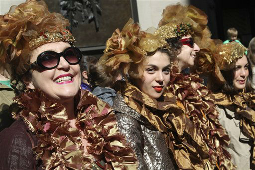 "<div class=""meta ""><span class=""caption-text "">The City Chicks pose for photographers during the Easter Parade on Fifth Ave.,  Sunday, April 8, 2012 in New York.  (AP Photo/Mary Altaffer) (AP Photo/ Mary Altaffer)</span></div>"