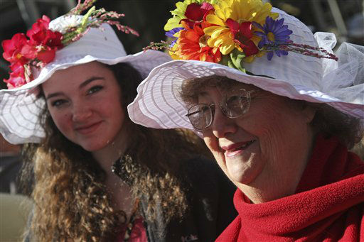 Rebecca Grabert, left, of Thibodaux, La., and her grandmother Mary Caillout wear flower hats during the Easter Parade on  Fifth Ave.,  Sunday, April 8, 2012 in New York.  &#40;AP Photo&#47;Mary Altaffer&#41; <span class=meta>(AP Photo&#47; Mary Altaffer)</span>