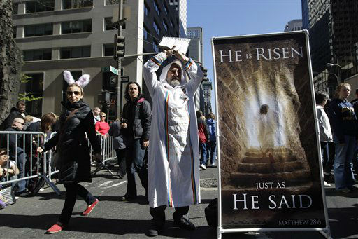 A woman wearing rabbit ears walks past a man who is proselytizing during the Easter Parade on Fifth Ave.,  Sunday, April 8, 2012 in New York.  &#40;AP Photo&#47;Mary Altaffer&#41; <span class=meta>(AP Photo&#47; Mary Altaffer)</span>