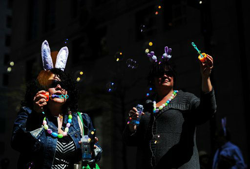 Lina Garcia, left, and Laura Hutchinson, both of Toronto, blow bubbles during the Easter Parade along New York&#39;s Fifth Avenue, Sunday, April 8, 2012. &#40;AP Photo&#47;Jeffrey Furticella&#41; <span class=meta>(AP Photo&#47; Jeffrey Furticella)</span>