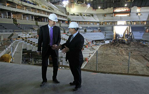 Mikhail Prokhorov, left, Russian billionaire and owner of the New Jersey Nets basketball team,  and Bruce Ratner, developer of the Barclays Center arena, speak during a news conference on Tuesday, April 10, 2012 at the arena&#39;s construction site in Brooklyn, N.Y.     &#40;AP Photo&#47;Bebeto Matthews&#41; <span class=meta>(AP Photo&#47; Bebeto Matthews)</span>