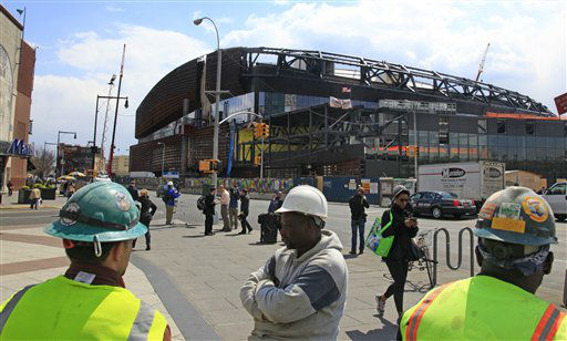 Construction workers take a lunchtime break from work at the Barclays Center arena on Tuesday, April 10, 2012 in the Brooklyn borough of New York.  Mikhail Prokhorov, the Russian billionaire owner of the New Jersey Nets basketball team, surveyed the ongoing construction for the Nets new home and said he&#39;s &#34;very committed&#34; to bringing an NBA title to Brooklyn.  &#40;AP Photo&#47;Bebeto Matthews&#41; <span class=meta>(AP Photo&#47; Bebeto Matthews)</span>