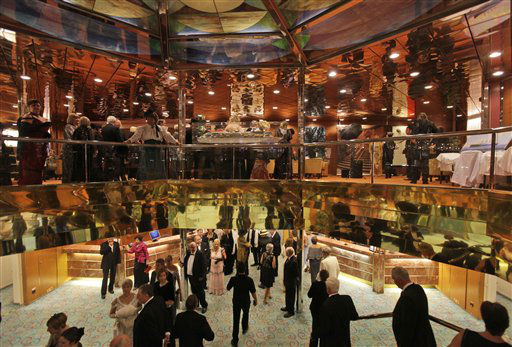 Passengers walk around the MS Balmoral Titanic memorial cruise ship, prior to the gala dinner in the Atlantic Ocean, Tuesday, April 10, 2012. Nearly 100 years after the Titanic went down, the cruise with the same number of passengers aboard is setting sail to retrace the ship&#39;s voyage, including a visit to the location where it sank. The Titanic Memorial Cruise departed Sunday, April 8, from Southampton, England, where the Titanic left on its maiden voyage and the 12-night cruise will commemorate the 100th anniversary of the sinking of the White Star liner. With some 1,300 passengers aboard, the MS Balmoral will follow the same route as the Titanic and organizers are trying to recreate the onboard experience minus the disaster from the food to a band playing music from that era. &#40;AP Photo&#47;Lefteris Pitarakis&#41; <span class=meta>(AP Photo&#47; Lefteris Pitarakis)</span>