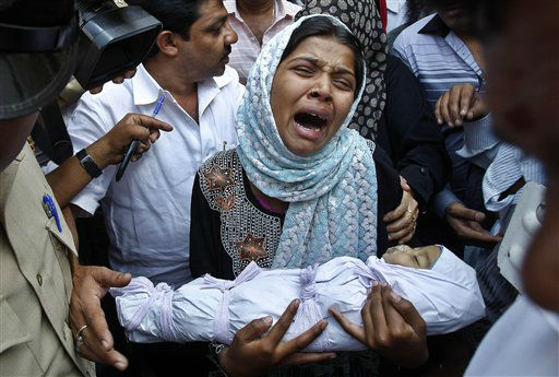 Reshma Bano wails as she holds the body of her three-month-old daughter Neha Afreen outside a hospital morgue in Bangalore, India, Wednesday, April 11, 2012. Afreen was admitted in the hospital on April 8 after allegedly being battered by her father for being born a girl. &#40;AP Photo&#47;Aijaz Rahi&#41; <span class=meta>(AP Photo&#47; Aijaz Rahi)</span>