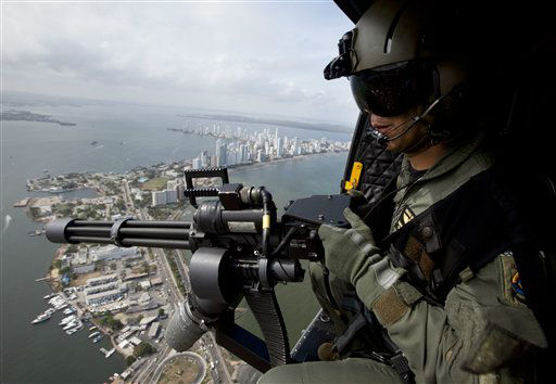 A navy helicopter patrols over Cartagena, Colombia, Thursday April 12, 2012. Western Hemisphere leaders will gather this weekend for the sixth Summit of the Americas in the colonial-era port city. &#40;AP Photo&#47;Fernando Vergara&#41; <span class=meta>(AP Photo&#47; Fernando Vergara)</span>