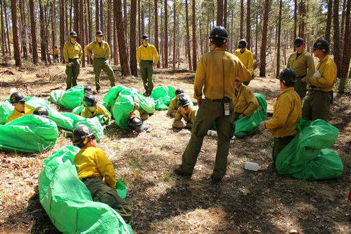 In this 2012 photo provided by the Cronkite News, Phillip Maldonado, a squad leader with the Granite Mountain Hotshots, trains crew members on setting up emergency fire shelters. On Sunday, June 30, 2013, 19 members of the Prescott, Ariz.-based crew were killed in the deadliest wildfire involving firefighters in the U.S. for at least 30 years. The firefighters were forced to deploy their emergency fire shelters - tent-like structures meant to shield firefighters from flames and heat - when they were caught near the central Arizona town of Yarnell, according to a state forestry spokesman. &#40;AP Photo&#47;Cronkite News, Connor Radnovich&#41; <span class=meta>(AP Photo&#47; Connor Radnovich)</span>