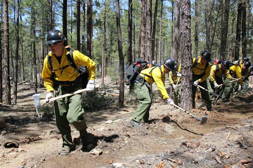"<div class=""meta ""><span class=""caption-text "">In this 2012 photo provided by the Cronkite News, the Granite Mountain Hotshot crew clears a fire line through the forest. On Sunday, June 30, 2013, 19 members of the Prescott, Ariz.-based crew were killed in the deadliest wildfire involving firefighters in the U.S. for at least 30 years. The firefighters were forced to deploy their emergency fire shelters - tent-like structures meant to shield firefighters from flames and heat - when they were caught near the central Arizona town of Yarnell, according to a state forestry spokesman. (AP Photo/Cronkite News, Connor Radnovich) (AP Photo/ Connor Radnovich)</span></div>"