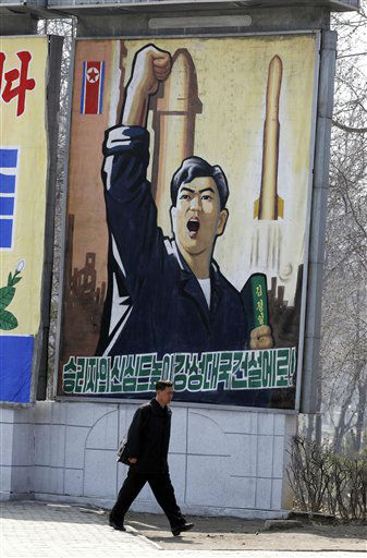 A North Korean man walks past a propaganda billboard in Pyongyang, North Korea, Friday, April 13, 2012. North Korea&#39;s much-anticipated rocket launch ended quickly in failure early Friday, splintering into pieces over the Yellow Sea soon after takeoff, according to South Korean and U.S. officials. The slogan reads &#34;Let&#39;s raise the spirits of winners and build a strong and prosperous nation!&#34; &#40;AP Photo&#47;Ng Han Guan&#41; <span class=meta>(AP Photo&#47; Ng Han Guan)</span>