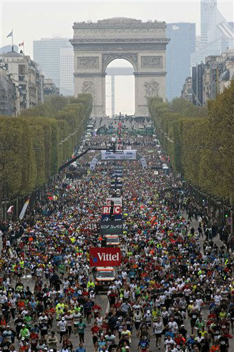 The runners taking part in the 36th Paris Marathon, at the start of the race on the Champs Elysees, in Paris, Sunday April 15, 2012. (AP Photo/Thibault Camus)