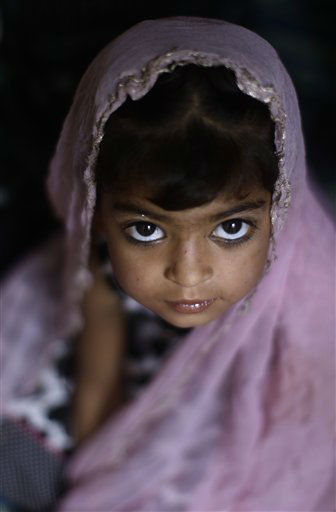 A Pakistani Christian Orthodox girl looks up while attending with her family an Orthodox Easter mass held at Saint Mary's Coptic Orthodox Church in Islamabad, Pakistan, Sunday, April 15, 2012. (AP Photo/Muhammed Muheisen)
