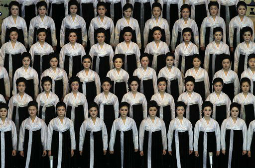 North Korean performers pause before singing at the Pyongyang indoor gymnasium to commemorate late president Kim Il Sung&#39;s 100th birthday in Pyongyang, North Korea, Monday, April 16, 2012. &#40;AP Photo&#47;Vincent Yu&#41; <span class=meta>(AP Photo&#47; Vincent Yu)</span>