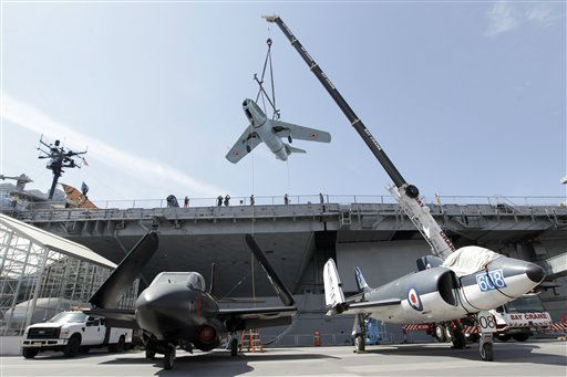 A Mikoyan Gurevich MIG-15 aircraft is removed from the deck of the The Intrepid Sea, Air and Space Museum, Wednesday, April 18, 2012 in New York. In the foreground are a a Douglas F3D-2 &#40;F-10&#41; Skyknight, left and a Supermarine Scimitar F.1 British Royal Navy fighter bomber. The museum moved three aircrafts from its flight deck Wednesday to make room for the space shuttle Enterprise.  &#40;AP Photo&#47;Mary Altaffer&#41; <span class=meta>(AP Photo&#47; Mary Altaffer)</span>