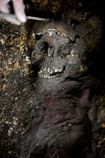 "<div class=""meta ""><span class=""caption-text "">A forensic anthropologist works on human remains during an exhumation in a military regiment in  Coban, Guatemala, Wednesday, April 18, 2012. Forensic experts say they have unearthed the remains of 99 Guatemalan civil war victims from clandestine graves inside a military unit and are searching for more. (AP Photo/Rodrigo Abd) (AP Photo/ Rodrigo Abd)</span></div>"
