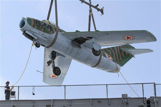 "<div class=""meta ""><span class=""caption-text "">A Mikoyan Gurevich MIG-15 aircraft is removed from the deck of the The Intrepid Sea, Air and Space Museum, Wednesday, April 18, 2012 in New York. The museum moved three aircrafts from its flight deck Wednesday  to make room for the space shuttle Enterprise.  (AP Photo/Mary Altaffer) (AP Photo/ Mary Altaffer)</span></div>"