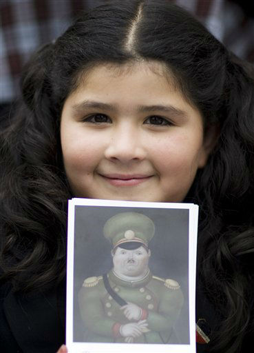 A school girl holds a postcard reproduction of a painting by Colombian painter Fernando Botero during his 80th birthday celebration at the Botero Museum in Bogota, Colombia, Thursday, April 19, 2012. &#40;AP Photo&#47;William Fernando Martinez&#41; <span class=meta>(AP Photo&#47; William Fernando Martinez)</span>
