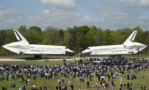 In this photo provided by the Smithsonian Institution via NASA, space shuttles Enterprise, left, and Discovery meet nose-to-nose at the beginning of a transfer ceremony at the Smithsonian&#39;s Steven F. Udvar-Hazy Center, Thursday, April 19, 2012, in Chantilly, Va. Space shuttle Discovery will take the place of Enterprise at the center to commemorate past achievements in space and retire as an artifact representing the 30-year shuttle program. &#40;AP Photo&#47;Smithsonian Institution via NASA, Carolyn Russo&#41; MANDATORY CREDIT <span class=meta>(AP Photo&#47; Carolyn Russo)</span>