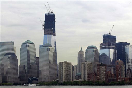 "<div class=""meta image-caption""><div class=""origin-logo origin-image ""><span></span></div><span class=""caption-text"">In this view from a ferry boat near Jersey City, N.J. , ongoing construction can be seen of One World Trade Center, left, and Four World Trade Center in lower Manhattan in the early Thursday, April 19, 2012. (AP Photo/Mel Evans) (AP Photo/ Mel Evans)</span></div>"