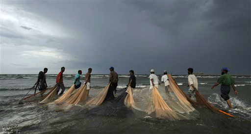 Pakistani fishermen drag their nets for fishing as heavy clouds gather in Karachi, Pakistan, Thursday, April 19, 2012. &#40;AP Photo&#41; <span class=meta>(AP Photo&#47; Uncredited)</span>