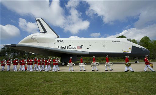 In this photo provided by NASA, the United States Marine Corp Drum and Bugle Corps and Color Guard march by the Space Shuttle Enterprise at the Steven F. Udvar-Hazy Center Thursday, April 19, 2012 in Chantilly, Va. Enterprise was the first space shuttle orbiter, built for NASA to perform test flights in the atmosphere and was not capable of spaceflight.  It has been on display at the Udvar-Hazy Center&#39;s Space Hangar since 2004.  Enterprise will be transferred to the Intrepid Sea, Air and Space Museum in New York City.  &#40;AP Photo&#47;NASA, Carla Cioffi&#41; MANDATORY CREDIT <span class=meta>(AP Photo&#47; Carla Cioffi)</span>