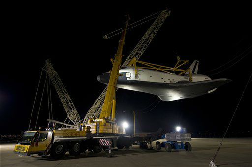 In this photo provided by NASA, the space shuttle  Enterprise is lifted in preparation for its mating to the NASA 747 Shuttle Carrier Aircraft for transport to New York at Washington Dulles International Airport, Friday, April 20, 2012, in Sterling, Va. Enterprise is expected to go on display at the Intrepid Sea Air and Space Museum in New York. &#40;AP Photo&#47;NASA, Bill Ingalls&#41; <span class=meta>(AP Photo&#47; Bill Ingalls)</span>