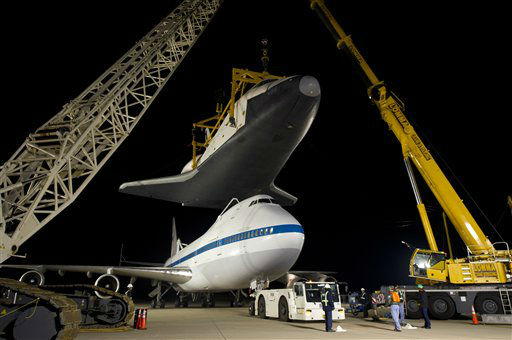 In this photo provided by NASA, the NASA 747 Shuttle Carrier Aircraft moves into place for mating underneath the space shuttle Enterprise for transport to New York at Washington Dulles International Airport, Friday, April 20, 2012, in Sterling, Va. Enterprise is expected to go on display at the Intrepid Sea Air and Space Museum in New York. &#40;AP Photo&#47;NASA, Bill Ingalls&#41; <span class=meta>(AP Photo&#47; Bill Ingalls)</span>