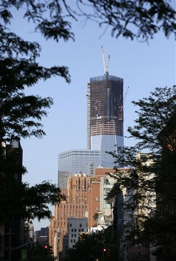 "<div class=""meta ""><span class=""caption-text "">Tower One, now up to 100 floors, rises above the SoHo neighborhood of New York, April 20, 2012. (AP Photo/Mark Lennihan) (AP Photo/ Mark Lennihan)</span></div>"