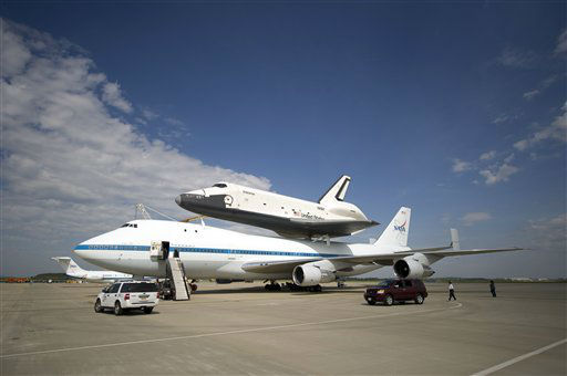 In this photo provided by NASA, the space shuttle Enterprise is mated on top of the NASA 747 Shuttle Carrier Aircraft at Washington Dulles International Airport Saturday, April 21, 2012, in Sterling, Va. Space Shuttle Transition and Retirement engineers Saturday completed the final steps to ready Space Shuttle Enterprise for its flight to New York&#39;s John F. Kennedy International Airport. The space shuttle&#39;s scheduled arrival in New York has been pushed back because of possible bad weather. NASA says Monday&#39;s planned arrival of the shuttle has been postponed &#34;until further notice.&#34;  Enterprise will go on permanent display at the Intrepid Sea Air and Space Museum in New York in June. &#40;AP Photo&#47;NASA, Bill Ingalls&#41; <span class=meta>(AP Photo&#47; Bill Ingalls)</span>