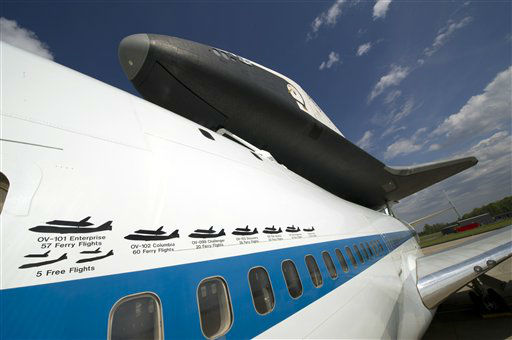 "<div class=""meta image-caption""><div class=""origin-logo origin-image ""><span></span></div><span class=""caption-text"">In this photo provided by NASA, the space shuttle Enterprise is mated on top of the NASA 747 Shuttle Carrier Aircraft at Washington Dulles International Airport Saturday, April 21, 2012, in Sterling, Va. Space Shuttle Transition and Retirement engineers Saturday completed the final steps to ready Space Shuttle Enterprise for its flight to New York's John F. Kennedy International Airport. The space shuttle's scheduled arrival in New York has been pushed back because of possible bad weather. NASA says Monday's planned arrival of the shuttle has been postponed ""until further notice.""  Enterprise will go on permanent display at the Intrepid Sea Air and Space Museum in New York in June. (AP Photo/NASA, Bill Ingalls) (AP Photo/ Bill Ingalls)</span></div>"