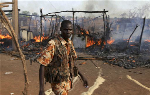 "<div class=""meta ""><span class=""caption-text "">A policeman walks past the smouldering remains of a market in Rubkona near Bentiu in South Sudan Monday, April 23, 2012. A boy was killed and at least two people were wounded Monday when Sudanese aircraft bombed an area near the town of Bentiu in South Sudan, an official and witness said, increasing the threat of a full-scale war breaking out between the two nations. (AP Photo/Michael Onyiego) (AP Photo/ Michael Onyiego)</span></div>"