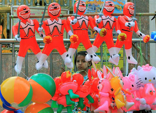 A Myanmar girl stands behind balloon toys in Yangon, Myanmar Monday, April 23, 2012. &#40;AP Photo&#47;Sakchai Lalit&#41; <span class=meta>(AP Photo&#47; Sakchai Lalit)</span>