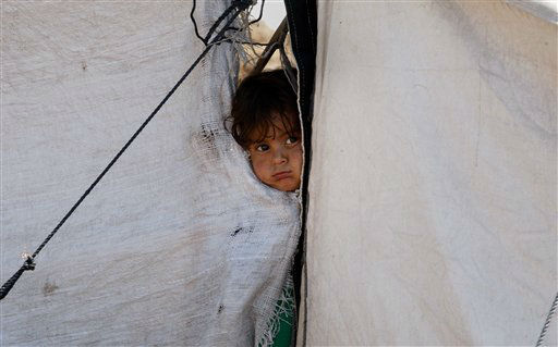 "<div class=""meta ""><span class=""caption-text "">A girl peers through gap of makeshift tents at Jalozai camp for internally displaced people near Peshawar, Pakistan on Monday, April 23, 2012. Thousands of people have fled from Pakistan's Khyber tribal region due to fighting between security forces and militants groups. Pakistani security forces have frequently conducted major operations to try and secure the country's western border with Afghanistan. (AP Photo/Mohammad Sajjad) (AP Photo/ Mohammad Sajjad)</span></div>"