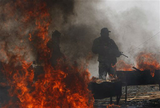 "<div class=""meta ""><span class=""caption-text "">Anti-narcotics police agents stands guard during the incineration of seized cocaine in La Rinconada on the outskirts of La Paz, Bolivia, Tuesday, April 24, 2012.  Anti-drug police burned over 300 kilograms (660 pounds) of drugs seized in various operations in the capital of La Paz, according to Police Colonel Gonzalo Quezada, director of Bolivia's special forces against drug trafficking (FELCN). (AP Photo/Juan Karita) (AP Photo/ Juan Karita)</span></div>"