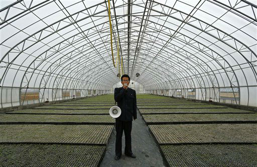 "<div class=""meta image-caption""><div class=""origin-logo origin-image ""><span></span></div><span class=""caption-text"">A North Korean official gives a briefing about a green house at the Central Tree Nursery in Pyongyang, North Korea, Tuesday, April 24, 2012. (AP Photo/Vincent Yu) (AP Photo/ Vincent Yu)</span></div>"