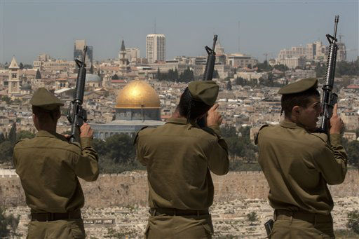 Israeli soldiers check their weapons following a Memorial Day ceremony on the Mount of Olives overlooking Jerusalem&#39;s Old City, Wednesday, April 25, 2012. &#40;AP Photo&#47;Sebastian Scheiner&#41; <span class=meta>(AP Photo&#47; Sebastian Scheiner)</span>