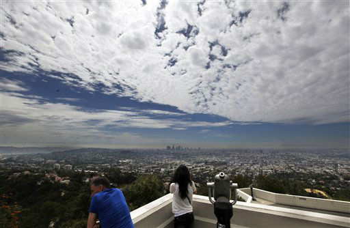 "<div class=""meta image-caption""><div class=""origin-logo origin-image ""><span></span></div><span class=""caption-text"">High clouds made for muggy weather over the Los Angeles basin, with downtown in the background, seen from Griffith Observatory Wednesday, April 25, 2012.  A storm moving in later Wednesday into Thursday was predicted to bring one to three inches of rain in Southern California. (AP Photo/Reed Saxon) (AP Photo/ Reed Saxon)</span></div>"
